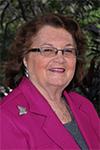 Commissioner Mikkie Belvedere